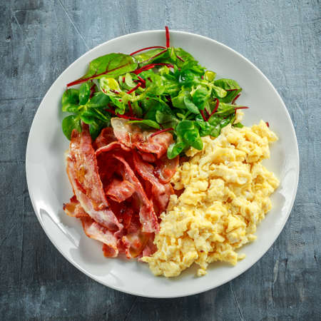 Morning Scrambled egg, bacon breakfast on white plate