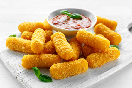 Breaded mozzarella cheese sticks with tomato basil sauce Stok Fotoğraf