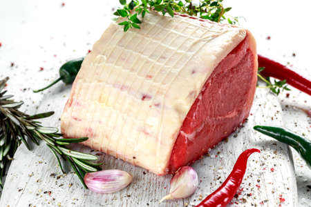 a pieces of fresh raw meat, beef slab, decorated with greens and vegetables. Stock Photo - 76106996