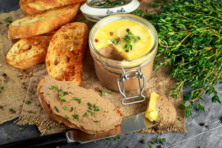Home made chicken liver pate with thyme and ciabatta bread in jar Stock Photo