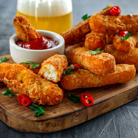 Crispy Halloumi cheese sticks Fries with Chili sauce for dipping. Stock Photo