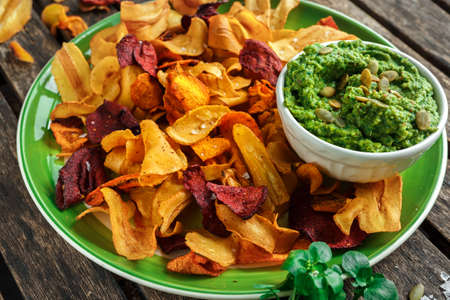 berro: Home made vegetable crisps from carrots, parsnips and beetroot with watercress guacamole