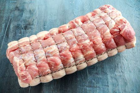 Raw Pork Loin cut ready to cook on rustic background