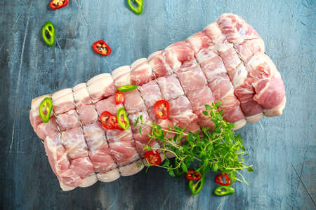 Raw Pork Loin cut ready to cook with chillies and thyme Stock Photo - 88124997