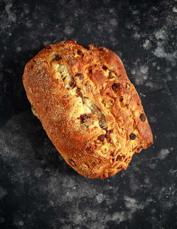 Rustic hand made organic bloomer bread with cranberry, raisin and cashew Stock Photo