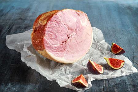 Festive ham sliced on crumpled rustic paper
