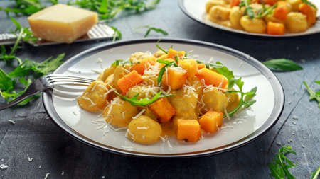 Homemade Butternut squash gnocchi with wild rocket and parmesan cheese Stock Photo