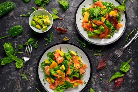 Fresh salmon salad with avocado, orange and green vegetables. Stock Photo