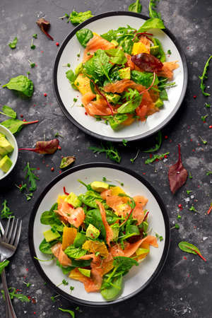 Fresh salmon salad with avocado, orange and green vegetables. Stok Fotoğraf