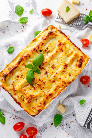 Homemade lasagna with minced beef bolognese and bechamel sauce topped wild basil, parmesan cheese Stock Photo