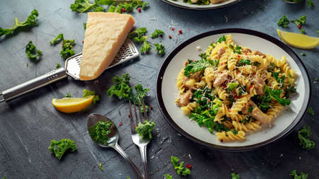 Homemade Pasta fusilli with Chicken, Green Kale, Garlic, lemon and parmesan cheese. healthy home food Stock Photo