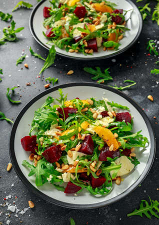 Fresh Beet, Orange salad with wild rocket, cheese and Pine nuts. healthy summer food