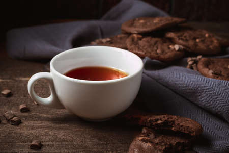 Delicious Tasty chocolate cookies with hot tea