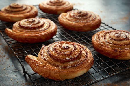 Freshly baked cinnamon swirls with icing sugar