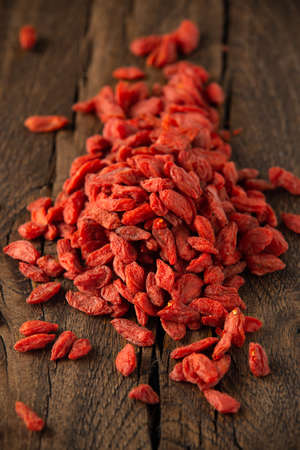 Dried fruits of Goji berries or wolfberry on rustic wooden table