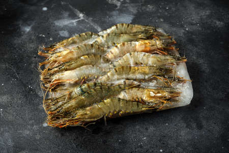 Frozen Raw Tiger prawns, seafood in a dark background Stok Fotoğraf