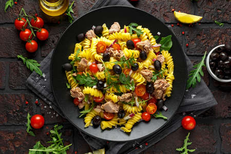 Pasta Tuna salad with tomatoes, wild rocket, black olives and red onion