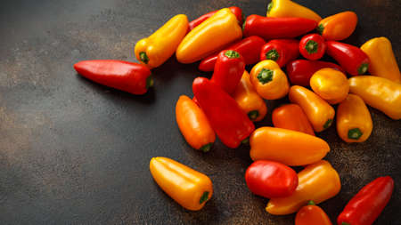 Fresh Sweet red, yellow and orange mini bell peppers. healthy raw vegetable food