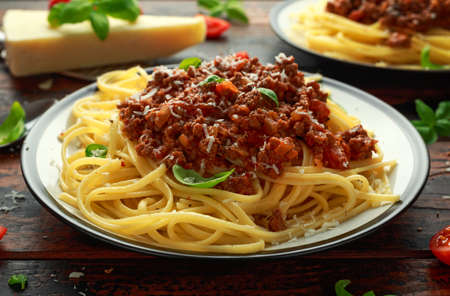 Italian pasta bolognese with beef, basil and parmesan cheese. Archivio Fotografico