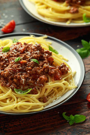 Italian pasta bolognese with beef, basil and parmesan cheese. Фото со стока