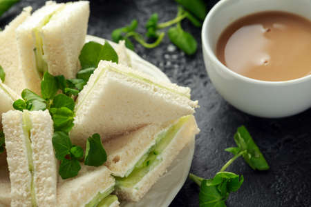 Cucumber sandwiches with soft cheese, sea salt and water cress for tea party Stock Photo