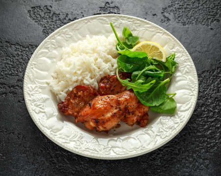 Roasted boneless skinless chicken thighs with rice and green vegetables mix