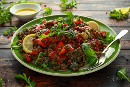 Lentil salad with roasted red pepper, zucchini and dry tomatoes, lemon. healthy food, vegetarian and vegan style