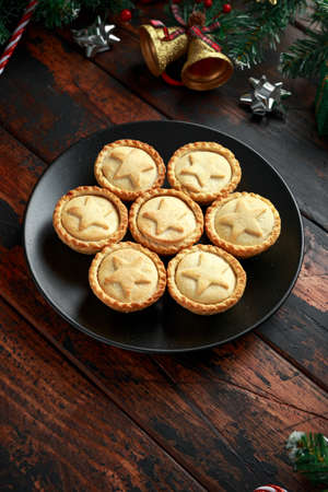 British Christmas mince pies with green christmas background Stock Photo - 113326444