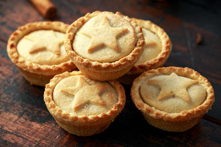 British Christmas mince pies with green christmas background