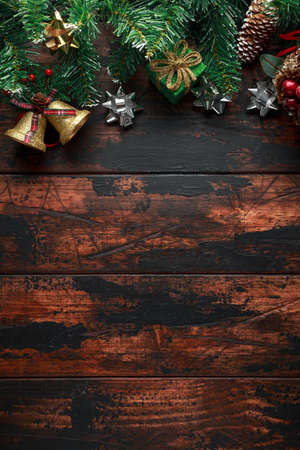Christmas background with fir tree and decoration on rustic wooden table Banco de Imagens