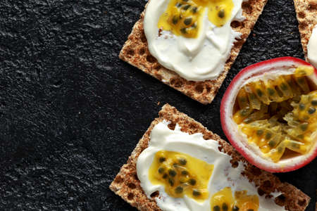 Rye breads with soy curd and maracuja, passion fruit. healthy breakfast