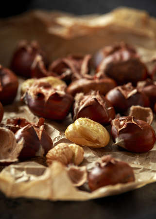Roasted chestnuts served on crumpled paper. food