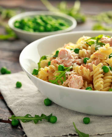 Homemade Pasta fusilli with salmon, green peas, parmesan cheese and lemon. close up. healthy food Reklamní fotografie