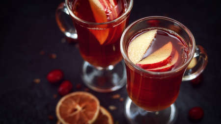 Mulled cider with spices and apple, orange fruit