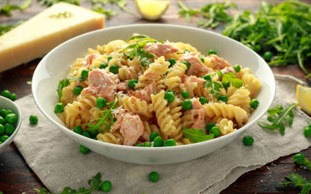 Homemade Pasta fusilli with salmon, green peas, parmesan cheese and lemon. healthy food Foto de archivo
