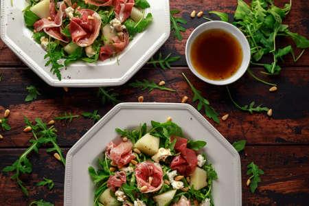 Parma ham and melon salad with mozzarella, rocket and pine nuts