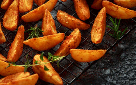 Paprika potato wedges fries chips, with ketchup and thyme.