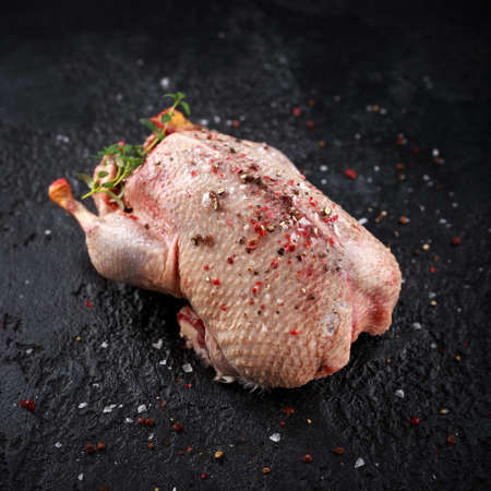 Raw wild mallard ducks seasoning with salt, pepper. ready to be cooked. Game or quarry birds. Stock Photo - 113669111