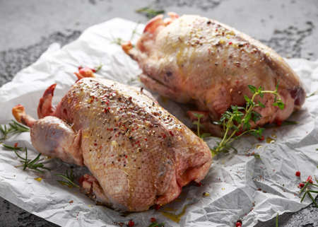 Raw wild mallard ducks Marinade with salt, pepper, herbs. ready to be cooked. Game or quarry birds Stock Photo