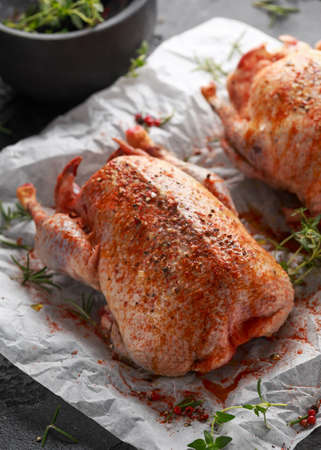 Raw wild mallard ducks Marinade with salt, pepper, herbs. ready to be cooked. Game or quarry birds Stock Photo - 114153582