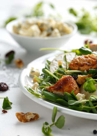 Pear, chicken salad with blue cheese, cranberry and walnuts. concept healthy food. white background