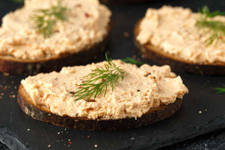 Fresh homemade smoked salmon pate on brown bread toast with dill Stock Photo