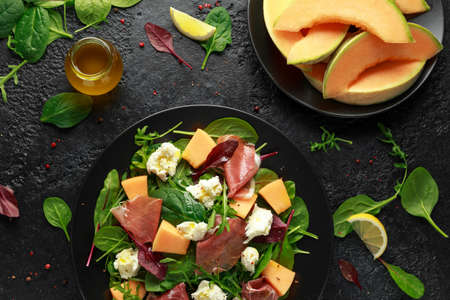 Parma ham and melon salad with mozzarella, green leaves mix