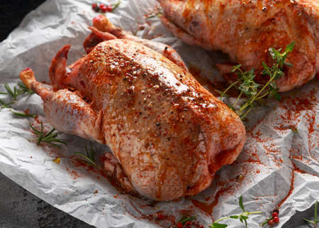 Raw wild mallard ducks Marinade with salt, pepper, herbs. ready to be cooked. Game or quarry birds Stock fotó
