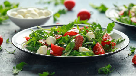 Chorizo salad with cherry tomatoes, mozzarella and wild rucola