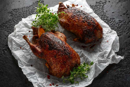 Grilled wild mallard ducks with orange and herbs. Stock Photo