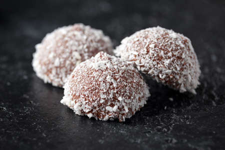 sweet mallow snowballs with chocolate coating and coconut