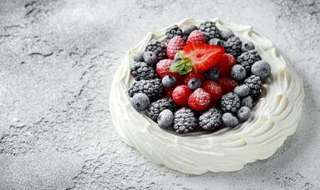 Berry Pavlova cake with fresh blueberries, strawberries and raspberries