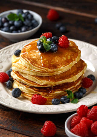 Homemade american pancakes with fresh blueberry, raspberries and honey. Healthy morning breakfast. rustic style Banco de Imagens