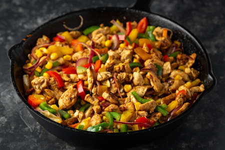 Fried Chicken breasts with bell pepper fajitas filling Stock fotó